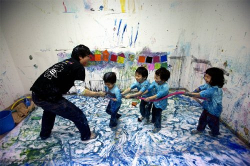 SIEHUNG, South Korea—Children smear paint around the room in this class to enhance creativity and expression, 2007. © Thomas Hoepker / Magnum Photos